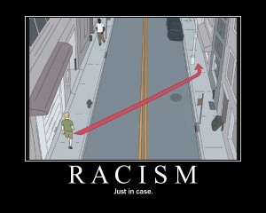 man crosses street to avoid man of different ethnicity