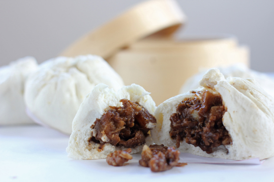 Siopao are the Chinese-style steamed buns, usually with pork or chicken inside, that are incredibly popular in the Philippines. They are typically brown on the inside, and yes, white and squishy like me on the outside.