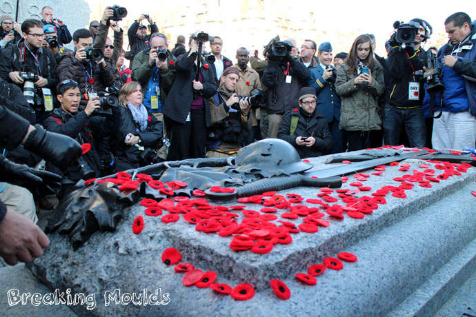 "Laying a poppy at the cenotaph. A little difficult to ""remember"" with all those cameras in your face..."