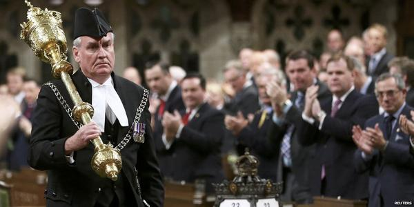 Kevin Vickers, Sergeant-At-Arms and credited with taking down the shooter, returns to work the next morning to a standing ovation.