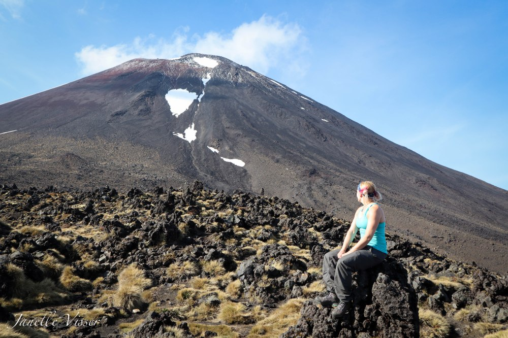 Janelle sitting in front of mt doom.jpg